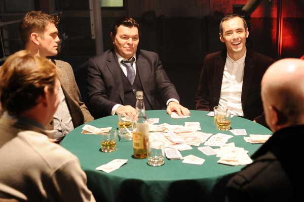 The men of Walford settle down for a poker night