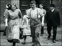 Workers leaving mill