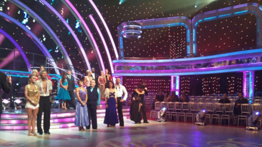 The Strictly couples standing in the ballroom.