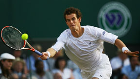 Andy Murray reaching for a forehand at Wimbledon.