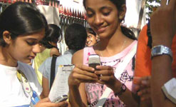 Girls in India using mobile phones