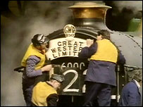 Workers repair a steam engine