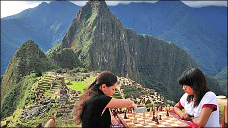 Women's world chess champion Alexandra Kosteniuk from Russia, left, plays Peruvian Under-16 world chess female champion Deysi Cori during one of a set of friendly games at the Inca citadel of Machu Picchu.