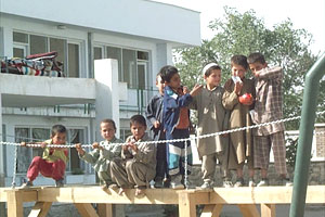 This orphanage has been taken to heart by the British soliders. They've built the children an adventure playground
