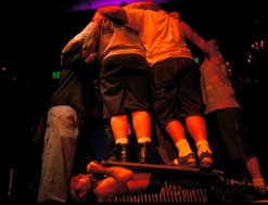 The Torture King lying on bed of nails with 4 people standing on him (copyright Jon Alloway)
