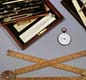 Brunel's drawing instruments including rulers and a pair of compasses.