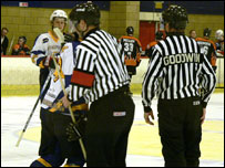 The officials control play