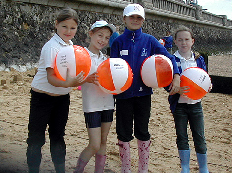 Group of children with beach balls