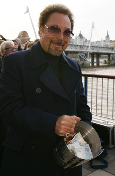 Tom Jones with the money he raised for charity from the Busking challenge