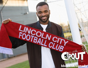 Darren Bent holding a Lincoln City FC scarf.