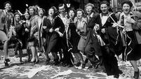 People dance in the streets of London on VE Day, 8 May 1945
