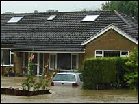House surounded by flood water