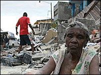 woman sits in rubble