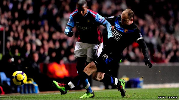 Wayne Rooney races back to tackle Ashley Young