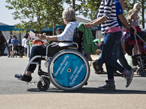 Wheelchair user in the Olympic Park during the London 2012 Paralympics