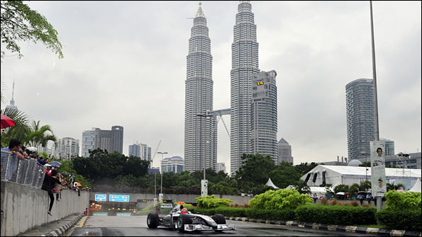 Michael Schumacher drives in front of the Petronas Towers