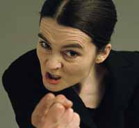 a female character making an aggressive gesture to the camera