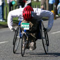 A wheelchair sportsman competing in a road race