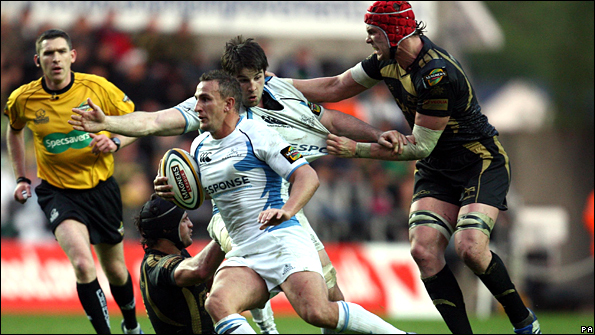 Glasgow Warriors' Colin Shaw attacks the Ospreys as Alun Wyn Jones and John Beattie contest during the Magners League match at the Liberty Stadium