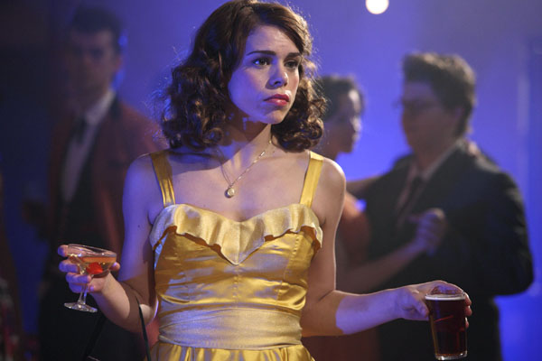 Billie Piper as Betty holds a gass of wine and a pint of beer in A Passionate Women