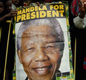 Cheering supporters hold up posters during Mandela's successful presidential campaign in 1994.