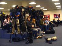 The cameras and journalists gathered inside the HSH Nordbank Arena in Hamburg for the Manchester City press conference