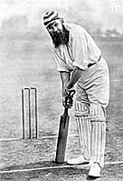 Black and white drawing showing British cricketer W G Grace at the crease