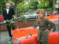 Prunella Scales with a lifesize Basil