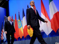 Gordon Brown walking behind Barack Obama