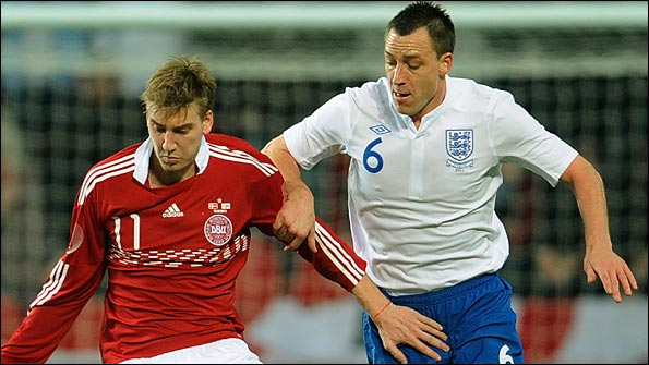 Terry takes on Denmark's Nicklas Bendtner