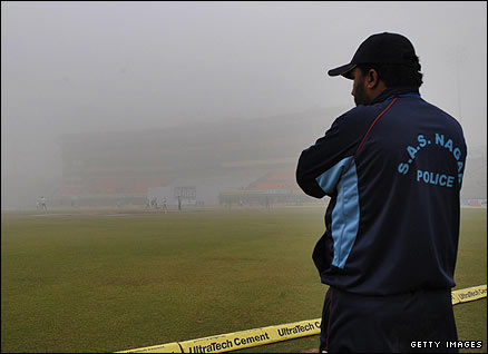 A Punjab police officer surveys a foggy scene
