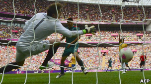 Brazil's goalkeeper Gabriel fails to catch a shot by Mexico's forward Oribe Peralta at Wembley stadium