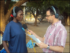 Trainee Lillian Ochoo preparing to contribute to a programme in Sudan alongside BBC World Service journalist Damian Zane