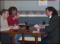 Group talking in a pub