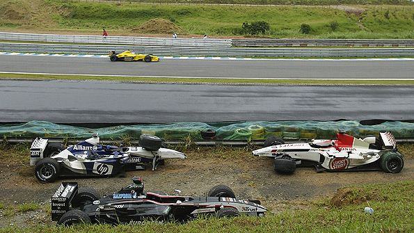 Eventual winner Giancarlo Fisichella follows the safety car as they pick their way through the debris left by massive crashes involving Mark Webber and Fernando Alonso at the 2003 Brazilian Grand Prix