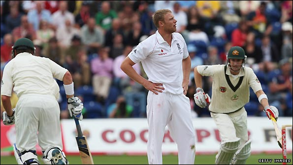 Andrew Flintoff shows his frustration as Michael Clarke and Marcus North pile on the runs