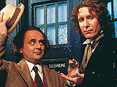 Sylvester McCoy hands over the TARDIS key to Paul McGann.