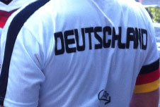 A man wearing a Germany football shirt