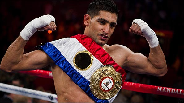 Amir Khan celebrates his victory
