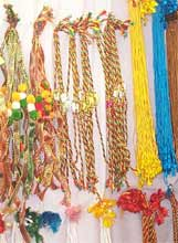 Colourful rakhis hanging on a wall ready to be exchanged