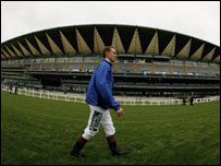 Jockey Martin Dwyer passes the new grandstand at Ascot Racecourse on May 27, 2006, in Ascot.