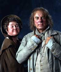 A man and woman in scruffy eighteenth century clothing