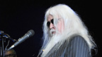 Leon Russell on piano during one of his solo songs.