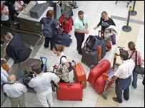 People with suitcases at airport