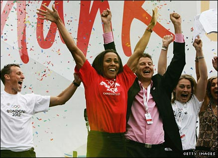 Danny Crates, Dame Kelly Holmes, Steve Cram and Sarah Webb jump for joy as they hear the good news on London winning the Olympic 2012 bid