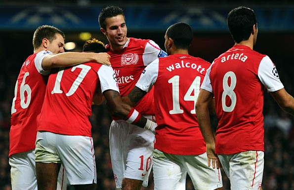Van Persie celebrates with his team-mates. Photo: Getty