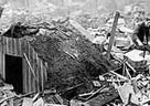 Photograph of an Anderson shelter intact after taking the full force of a bomb