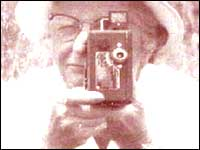 Person using an old camera