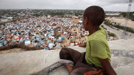 A boy looks down on Seyidka settlement for people displaced by famine.