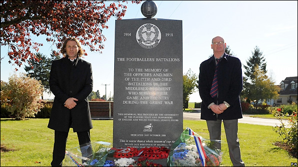 Gareth Ainsworth (left) and Phil Stant beside the memorial in Longueval.